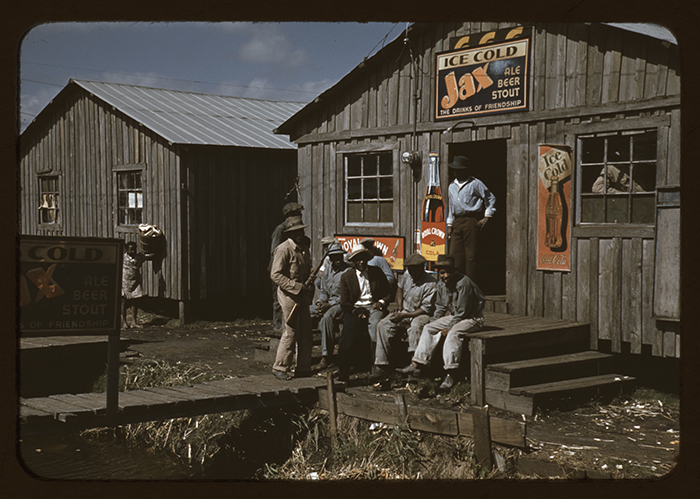 A 1941 photo taken for a Farm Security Administration project shows migrant workers on a break  in Belle Glade, Fla.