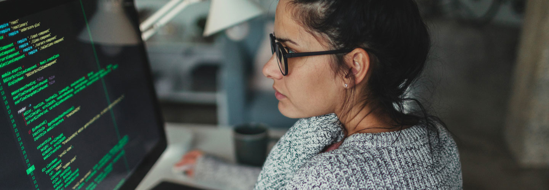 Millennial woman working at a computer