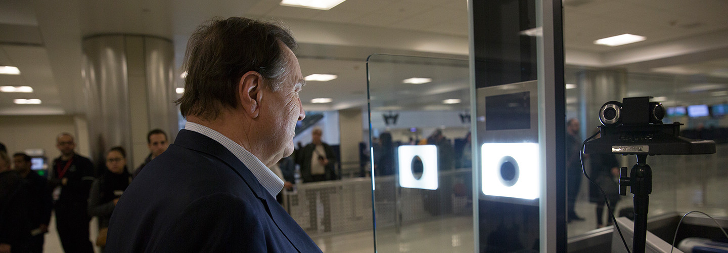 U.S. Customs and Border Protection officers screen international passengers arriving at the Dulles International Airport in Dulles, Va., November 29, 2016