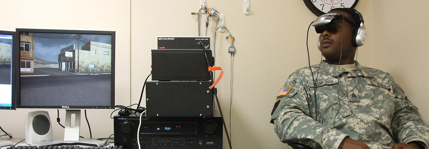 """Army Sgt. Lenearo Ashford, Technical Services Branch, Uniformed Services University, undergoes a demonstration of """"Virtual Iraq,"""" a life-like simulator that represents a new form of PTSD exposure therapy at Walter Reed Army Medical Center in Washington, D.C., on Sept. 16, 2008."""
