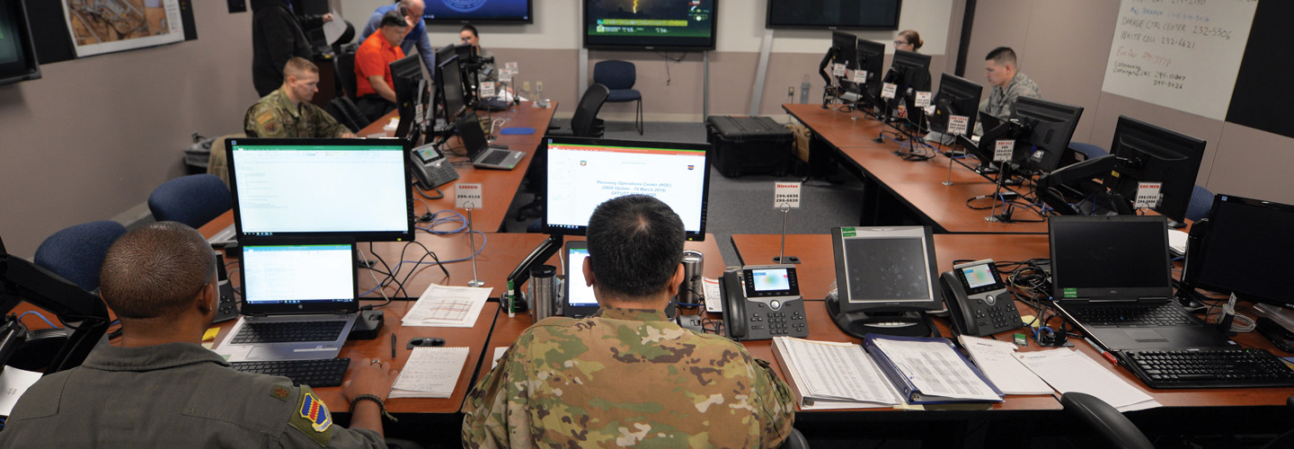 The 55th Wing's Recovery Operations Center staff works 16-hour shifts disseminating information to the base populace regarding the flooding caused by the Missouri River on March 19, 2019. The river breached the levee system, which widened the river's footprint, covering half the base.