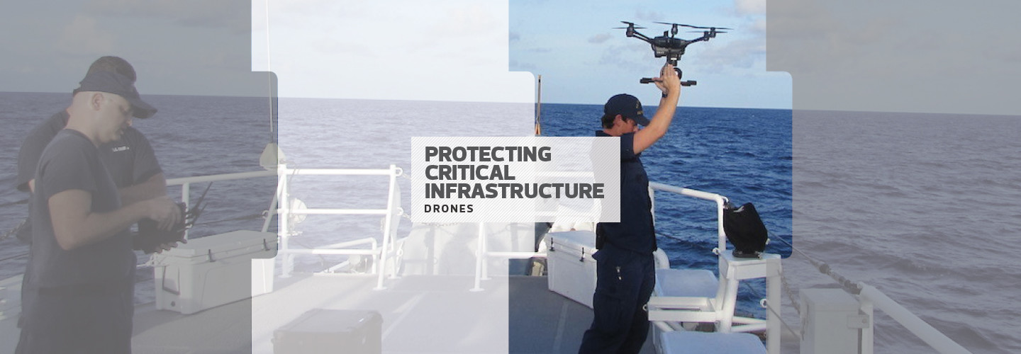 man in military uniform holding a drone over his head on a boat