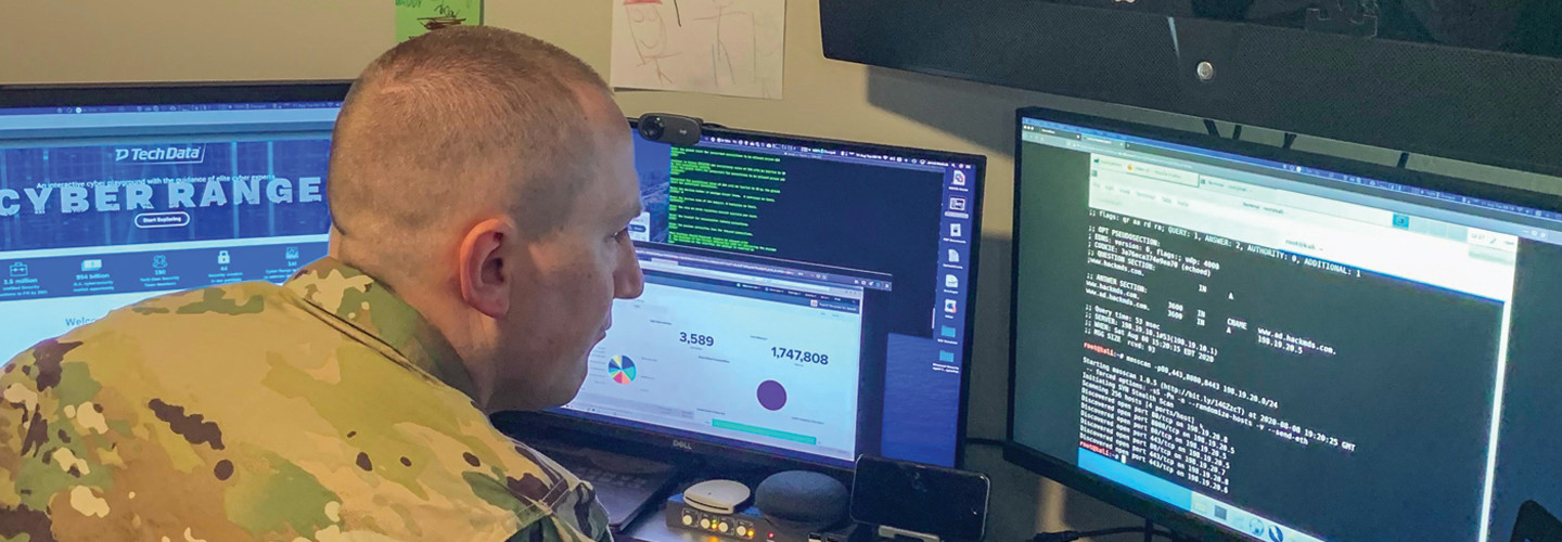 """U.S. Army Reserve Maj. Jared Hrabak, a cyber officer with Cyber Protection Team 185 uses a common network scanning tool """"masscan"""" to enumerate a network. during his unit's Virtual Battle Assembly Aug. 9, 2020."""