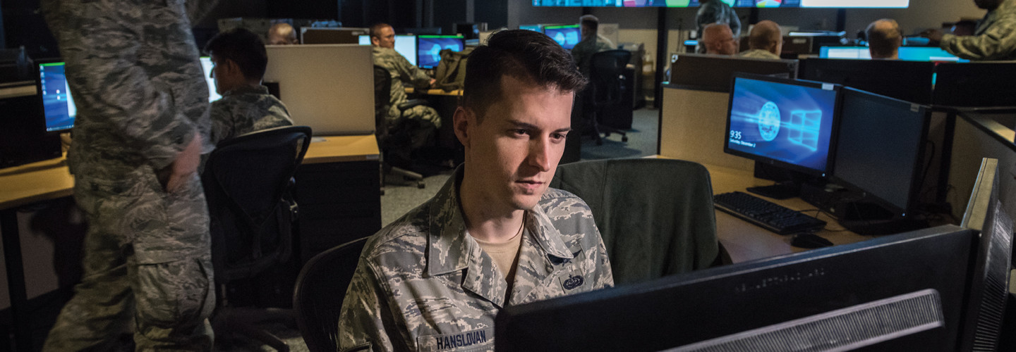 Tech. Sgt. Kyle Hanslovan, a cyber-warfare specialist serving with the 175th Cyberspace Operations Group of the Maryland Air National Guard, works in the Hunter's Den at Warfield Air National Guard Base, Middle River, Md., Dec. 2, 2017.