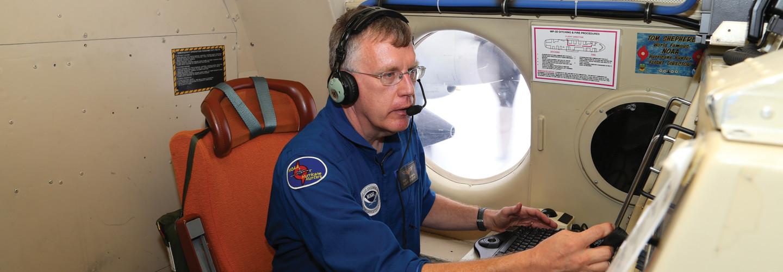Flight director Rich Henning on N42RF speaking into headset