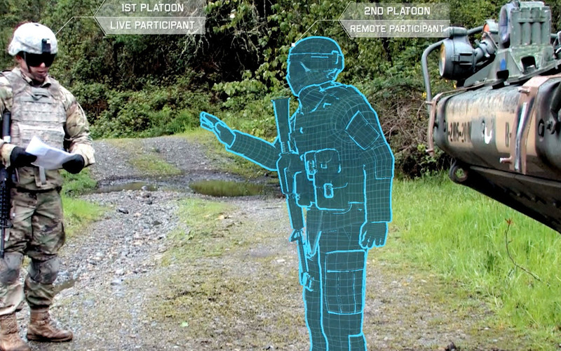 A Stryker vehicle commander interacts in real time with a remotely operated avatar. The United States Army Research Laboratory is working with other organizations to create a synthetic training environment that includes augmented reality.