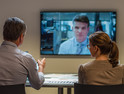 Federal workers in a videoconference meeting with a coworker
