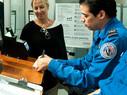 TSA officials checking passenger information