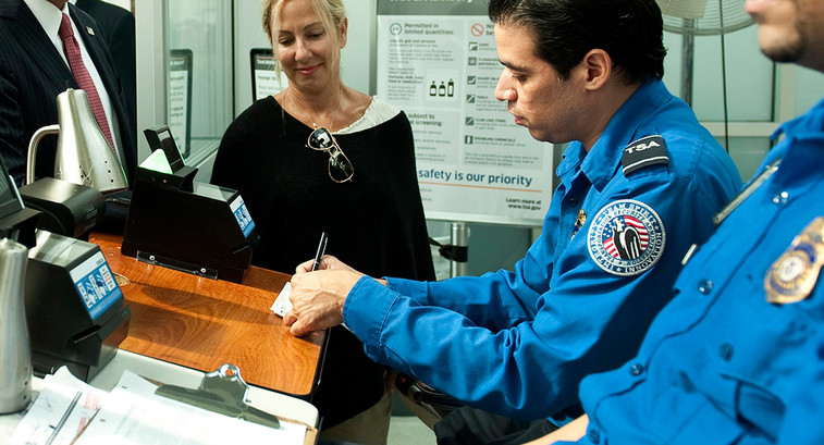 TSA officials checking passenger information