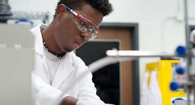 University of Connecticut undergraduate Nico Wright at work in Professor Michael Pettes' mechanical engineering laboratory.