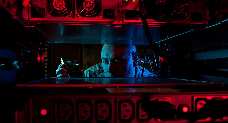 Air Force Staff Sgt. Jerome Duhan, a network administrator with the 97th Communications Squadron, inserts a hard drive into the network control center retina server at Altus Air Force Base, Okla., Jan. 24, 2014, in preparation for a command cyber readines inspection.