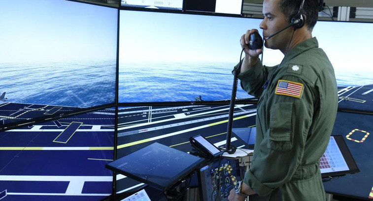 Commander Jason Cassisi, air boss aboard the aircraft carrier USS George H.W. Bush participates in a final prototype demonstration of the Office of Naval Research TechSolutions-sponsored Flight Deck Crew Refresher Training Expansion Packs.
