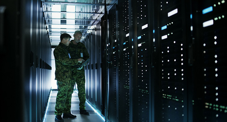 Army officers working in a data center