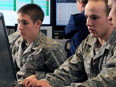 Cadet 1st Class Jordan Keefer (center) coordinates cadet efforts to defend their network during the National Security Agency's Cyber Defense Exercise at the U.S. Air Force Academy in Colorado Springs, Colo., April 17, 2012.