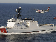 The U. S. Coast Guard's first national security cutter, the Bertholf, operating in concert an HC-144 maritime patrol aircraft and an MH-65 helicopter.