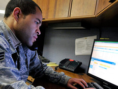 Senior Airman Jason McKenzie, client systems technician from the 436th Communications Squadron, troubleshoots a computer issue by remotely logging into a customer's computer Jan. 19, 2012, at Dover Air Force Base, Del.