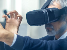 Federal worker manipulating a virtual object while wearing a VR headset