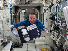 ESA astronaut Roberto Vittori posing for a photo with the eValuatIon And monitoring of microBiaL biofilms insidE ISS (VIABLE ISS) experiment.