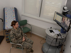 Senior Airman Kimberly Deveau sits in a private room at Spangdahlem Air Base, Germany as she receives specialty genetic counseling via a video teleconference from Capt. (Dr.) Mauricio De Castro, staff medical geneticist at Keesler Air Force Base, Miss., Feb. 1, 2018