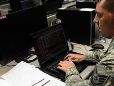 Tech. Sgt. Brad Davis, 119th Command and Control Squadron system administrator, participates in a class exercise in a Network War Bridge Course from the 39th Information Operations Squadron, Hurlburt Field, Fla., Sept. 19, 2014.