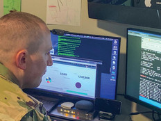 "U.S. Army Reserve Maj. Jared Hrabak, a cyber officer with Cyber Protection Team 185 uses a common network scanning tool ""masscan"" to enumerate a network. during his unit's Virtual Battle Assembly Aug. 9, 2020."