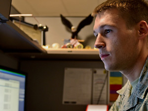Staff Sgt. Chris Meyer, a 28th Contracting Squadron contract administrator, reviews paperwork at Ellsworth Air Force Base, S.D., Nov. 4, 2015.
