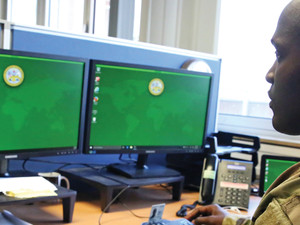 .S. Army Staff Sgt. Johnnie Robinson, 2nd Theater Signal Brigade command group noncommissioned officer, uses a government computer with Microsoft Windows 10 operating system, Oct. 2, 2017 in Wiesbaden, Germany.